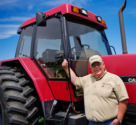 Joe Anchor with his Case International tractor